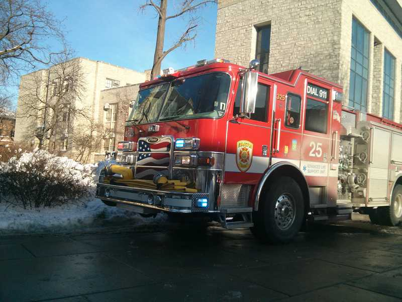 A fire truck comes to University Hall after a pipe burst Wednesday. Students and faculty in the building were evacuated.