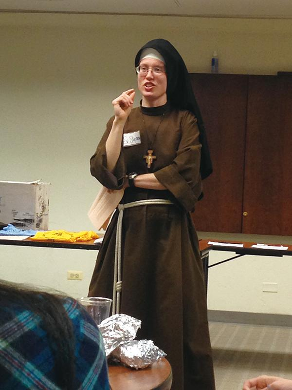 Stephanie+Baliga%2C+also+known+as+Sister+Stephanie+from+the+community+of+Franciscans+of+the+Eucharist%2C+speaks+at+Sheil+Catholic+Center+Wednesday+night.+Baliga+recounted+how+she+incorporated+sport+spirits+in+her+Christianity.+%0D%0A