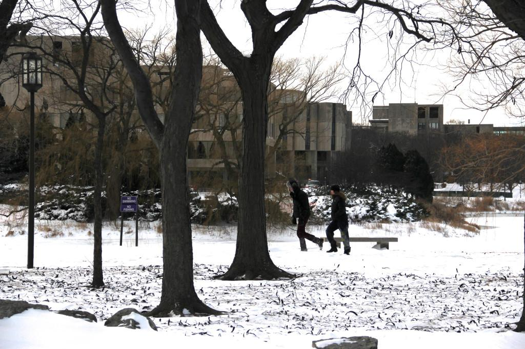 Students walk on the Lakefill. Northwestern was closed Tuesday for the second day in a row.