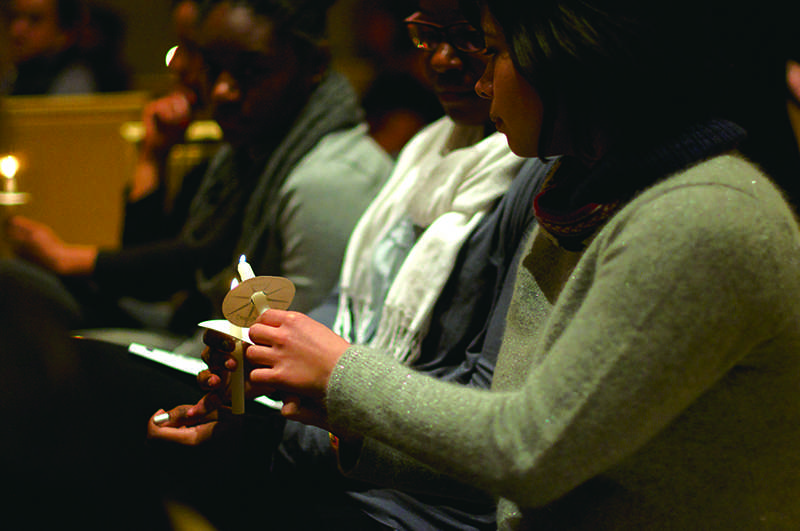 Evanston+residents+gathered+at+Alice+Millar+Chapel+for+the+vigil+Monday+night+in+memory+of+Martin+Luther+King+Jr.+The+candlelight+service+was+sponsored+by+Alpha+Phi+Alpha+fraternity.+%0D%0A