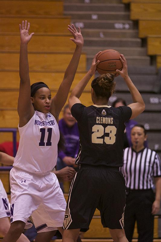 Sophomore forward Lauren Douglas plays defense in Thursday's win against No. 21 Purdue. Douglas had 5 points and five rebounds off the bench in the first half of Northwestern's loss Sunday to Minnesota.