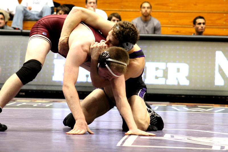 Junior Pierce Harger battles University of Chicago's Steven Franke. Harger said he is looking forward to wrestling Friday at his alma mater, Cincinnati's Archbishop Moeller High School, but is preparing for this match just like any other.