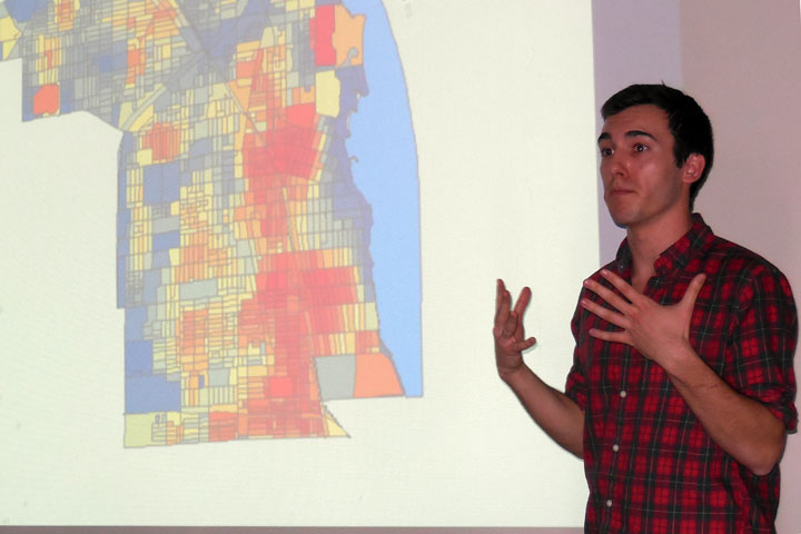 McCormick senior Graeme Murphy presents a map of Evanston based on population and employment density. The dark red areas are considered the most dense, which was taken into consideration when they planned possible Divvy bike stops for the future.