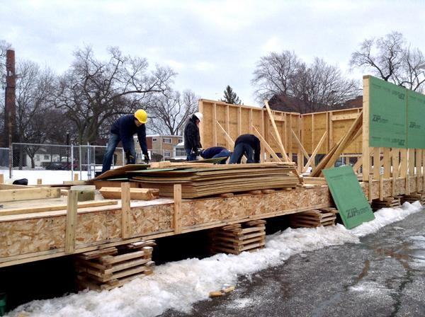 Evanston Township High School students and volunteers work together to build a house Saturday for a low-income family. The project is part of an ETHS class called Geometry in Construction.