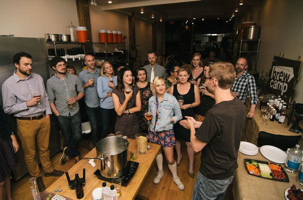 Visitors listen to a Brew Camp employee. The business recently opened a store in Evanston, 821 Chicago Ave., which offers about 50 types of grains and hops and 10 different yeasts.