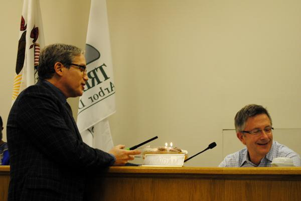 Neal Moglin presents his partner, Ald. Mark Tendam (6th) with cupcakes to celebrate his 59th birthday Monday at City Council.