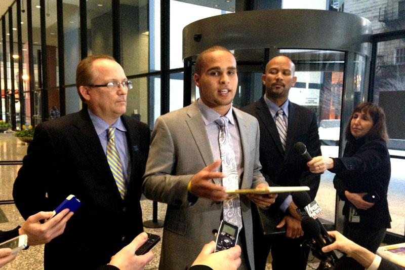 Former Northwestern quarterback Kain Colter — standing with National College Players Association president Ramogi Huma and United Steelworkers political director Tim Waters — addressed the media Tuesday. Three NU officials testified Thursday.
