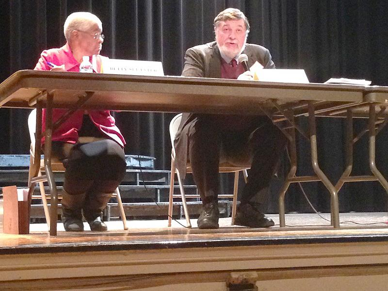 Cook County commissioner Larry Suffredin addresses attendees' questions at a forum Wednesday night. Community activist Betty Ester argued against the proposed dissolution of Evanston Township, a referendum Suffredin supports.