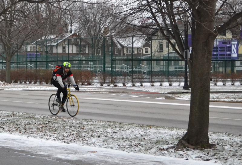 A cyclist bikes on Sheridan Road. City Council passed a resolution last month that will promote public access to alternative forms of transportation, such as bicycling.