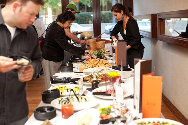 An employee serves food at Koi Fine Asian Cuisine & Lounge. Koi received the 2013 Arts & Business Committee Leadership Award in recognition of the restaurants support of arts organizations in Evanston.