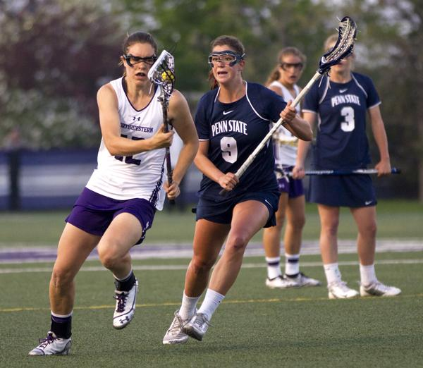 Sophomore midfielder Kaleigh Craig carries the ball into Northwestern's offensive third. Craig, the only non-senior to score more than 1 goal, led the Wildcats with 4 on six shots against the Blue Devils.