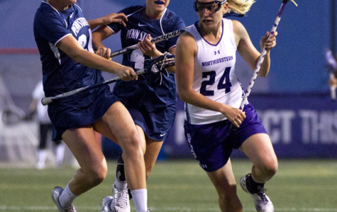 Senior midfielder Christy Turner evades defenders on a breakaway. Turner was one of 15 players to score against Marquette in Northwestern's first home game of the season, a 20-5 romp over the Golden Eagles.