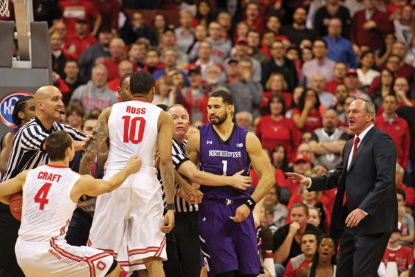 Referees separate senior forward Drew Crawford and Ohio States LaQuinton Ross. Crawford led Northwestern with 22 points Thursday but battled foul trouble down the stretch as the Wildcats collapsed against the Buckeyes.
