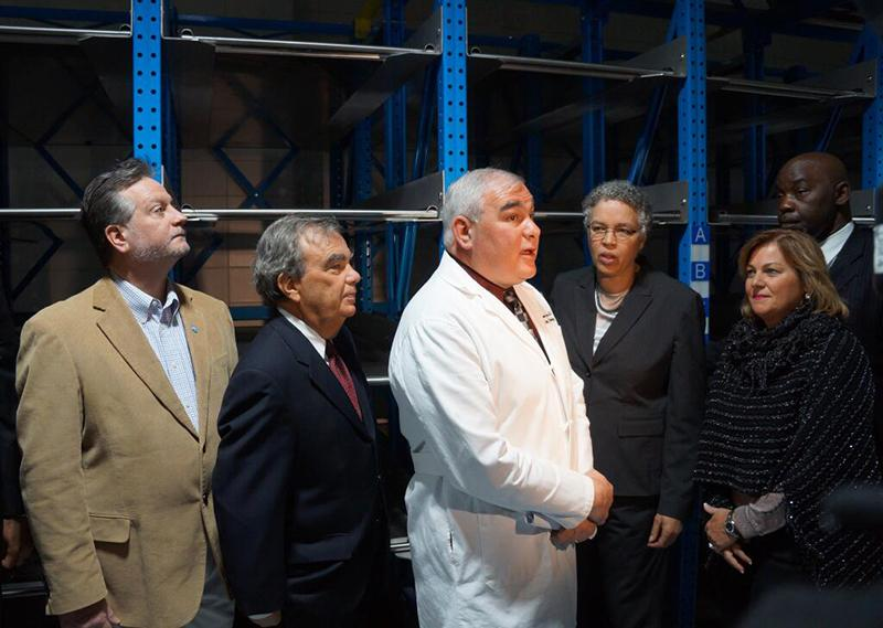 Dr. Stephen Cina, center, Cook County's chief medical examiner, speaks about the changes made within his agency. Cook County Board President Toni Preckwinkle announced Thursday the medical examiner's office has received provisional accreditation.