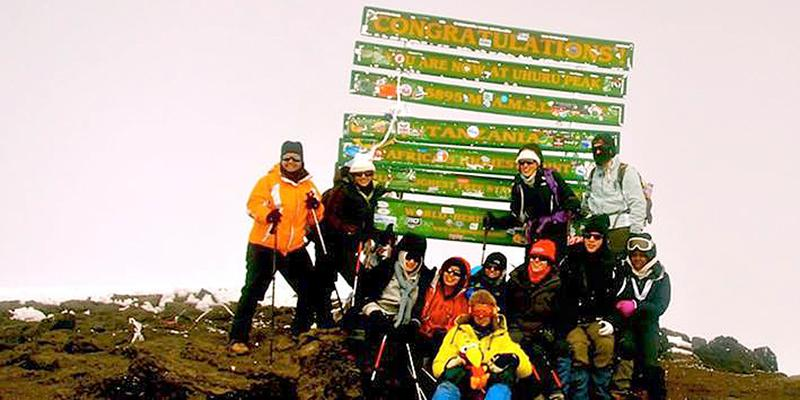 Mountains+for+Moms+climbers+from+Cornell+University+pose+for+a+photo+at+the+summit+of+Mount+Kilimanjaro+in+January+2014.+A+team+of+Northwestern+students+is+scheduled+to+climb+the+mountain+in+August+2014.