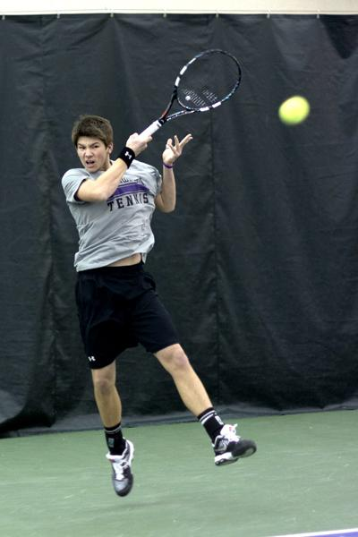 Freshman Strong Kirchheimer, who played the No. 4 singles spot in a 4-3 loss against Harvard on Friday, returns his opponent's shot. Kirchheimer's loss in a three-set tiebreaker was the last match in a quick succession of singles losses for the Wildcats.