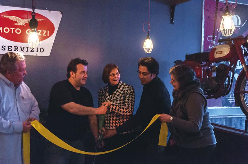 Evanston business owners and Mayor Elizabeth Tisdahl attended La Macchina Cafe's ribbon cutting in January. The cafe, 1620 Orrington Ave., opened in the fall.