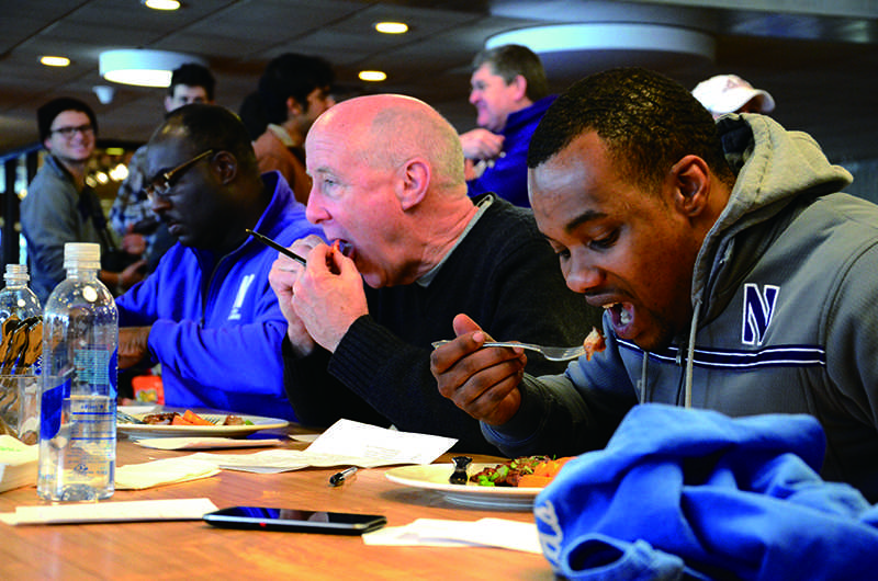 Judges sample dishes Saturday at the Top Chef competition in Norris University Center. The competition benefited Dance Marathon.