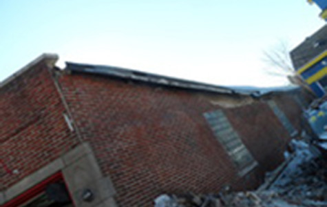 A portion of a wall for Suds Car Wash, 2212 Green Bay Road, collapsed Friday.
