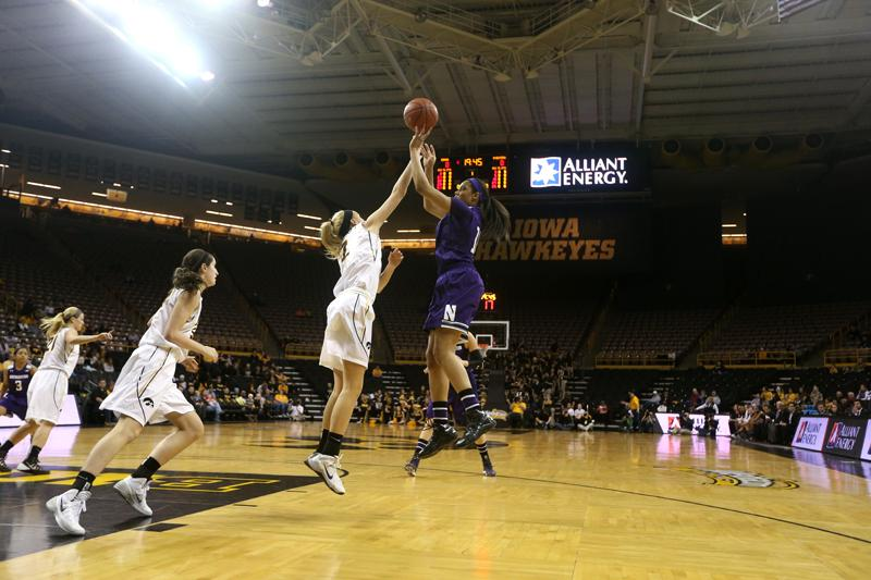 Freshman Nia Coffey attempts a shot. The forward, in her first full game back from a foot injury, posted a career-high 29 points en route to her seventh double-double this season.