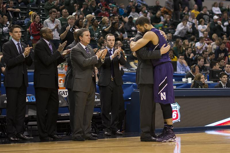 Coach+Chris+Collins+hugs+senior+forward+Drew+Crawford+as+he+ends+his+Northwestern+career.+Crawford+moved+into+second+place+in+NU%27s+all-time+scoring+list+during+the+67-51+loss+to+Michigan+State.+
