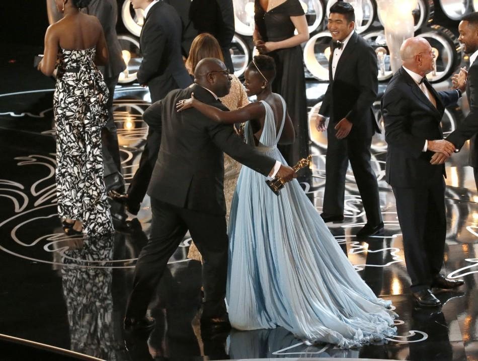 Steve+McQueen+leans+in+to+kiss+Lupita+N%27yongo+as+%2212+Years+a+Slave%22+celebrates+on+stage+during+the+86th+annual+Academy+Awards.+McQueen+and+N%27yongo+were+just+two+of+the+many+international+artists+who+swept+the+Oscars+this+year.