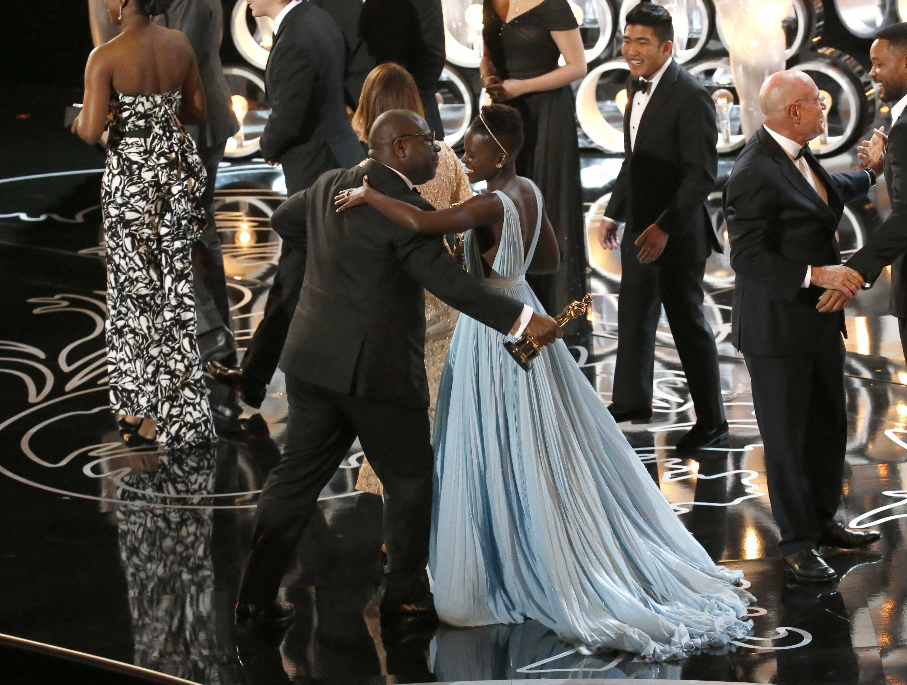 Steve McQueen leans in to kiss Lupita N'yongo as