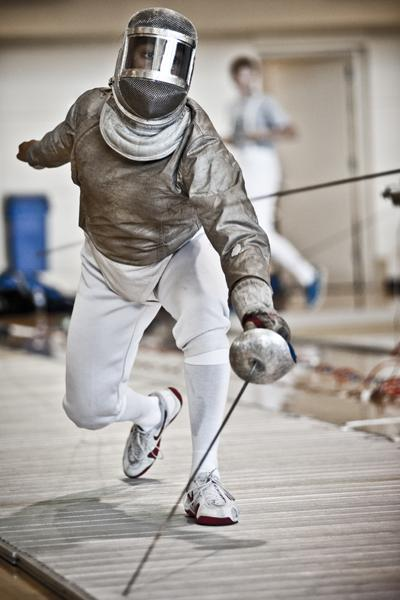 Freshman sabre Alisha Gomez-Shah lunges at her opponent in a past match. Though the team's lone senior, Dina Bazarbayeva, took home gold in epee, the team's overall bronze was the result of a good effort from old and young.