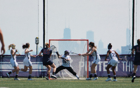 Junior goalkeeper Bridget Bianco lunges to make a save. Bianco recorded eight saves in Northwestern loss to Notre Dame on Wednesday.