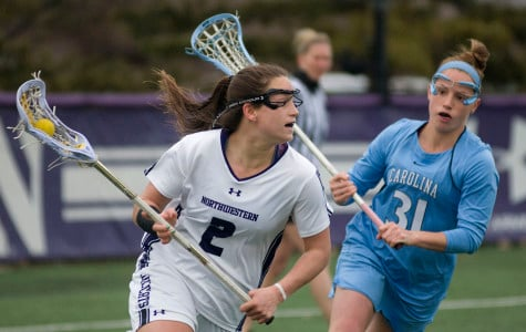 Senior Alyssa Leonard, who led Northwestern with 3 goals, carries the ball into North Carolina's third on Monday. Leonard also led the team with three draw controls.