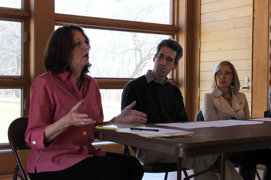 Anne Sills, a member of the Community Legislative Committee of school districts 65 and 202, talks at a community food discussion Sunday hosted by state Sen. Daniel Biss, center, and state Rep. Robyn Gabel, right, at the Evanston Ecology Center.