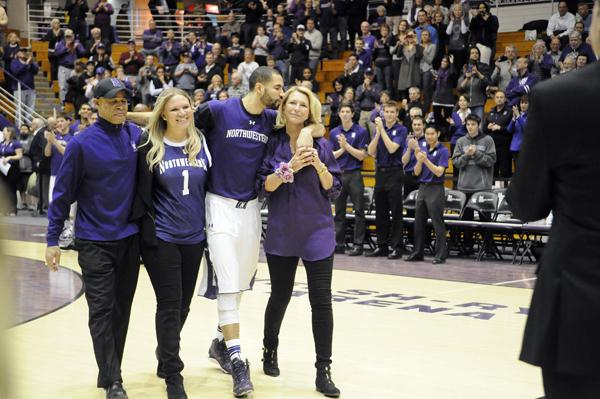 Senior forward Drew Crawford walks onto the Welsh-Ryan Arena floor for the final time during Northwestern's Senior Night festivities. Crawford scored just 6 points in his home finale.