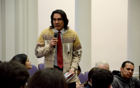 Andrew Johnson, executive director of the American Indian Center of Chicago, speaks at the Native and Indigenous Northwestern Community Forum Tuesday evening at Harris Hall. Johnson voiced his support for the efforts undertaken by the Native American and Indigenous Student Alliance to push NU toward a reconciliation process regarding John Evans' role in the Sand Creek Massacre.
