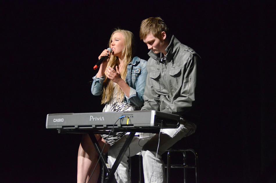 "Sophomore basketball forward Kale Abrahamson performs Rihanna's ""Stay"" with his sister Kaya. The two won second place by audience vote."