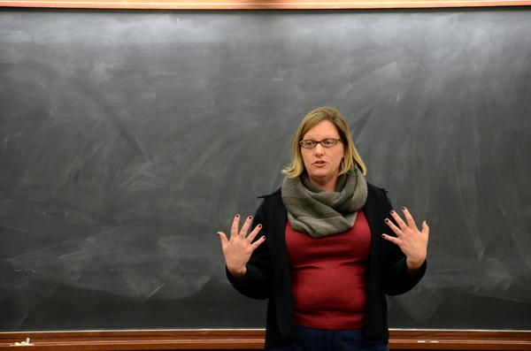 Sociology Prof. Laura Beth Nielsen, the director of legal studies, speaks Monday evening at an open forum on Title IX in Harris Hall. Nielsen talked about ways to address sexual harassment and procedures for making Northwestern's campus safer.