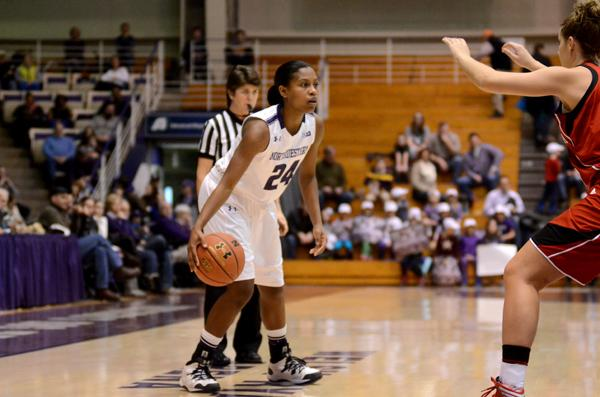 Freshman guard Christen Inman looks to pass. Northwestern's success this season has largely depended on the success of its freshman, who often lead the Wildcats in games and make up three of the team's five usual starters.
