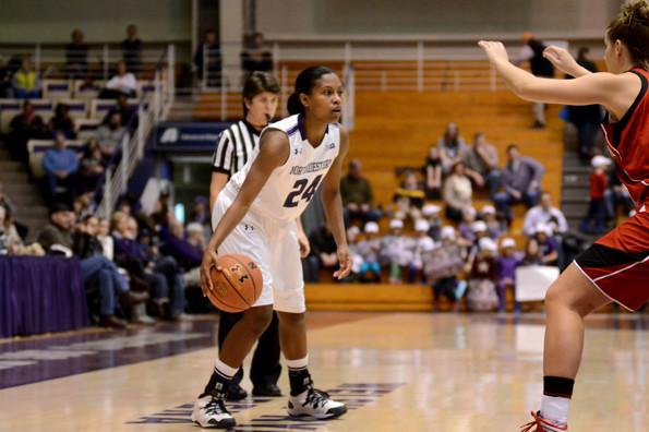 Freshman guard Christen Inman looks to pass. Inman's clutch jump shot with 20 seconds left helped Northwestern past Ball State on Thursday in the first round of the Women's NIT.
