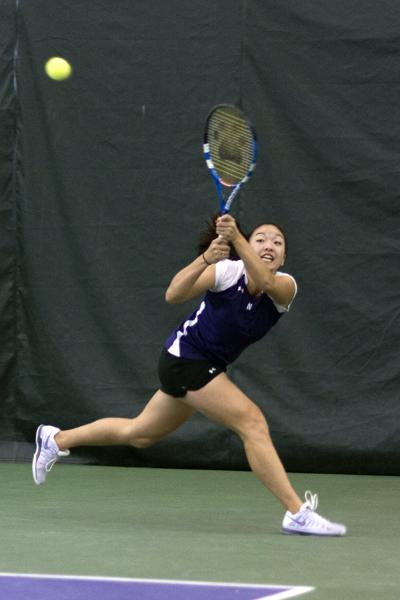 """Senior Belinda Niu won her doubles match, then prevailed in a three-hour singles showdown with Purdue's Daniela Vidal. The Wildcats topped the Boilermakers 4-3. """"What would we do without Belinda Niu?"""" coach Claire Pollard said."""