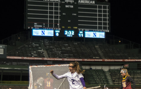 Draw control specialist Alyssa Leonard cheers after Northwestern's final goal in its win against Southern California. The senior kicked off her last regular-season game's second half with a behind-the-back goal.