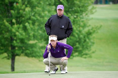 Pat Goss peers over his player as he sizes up a putt. Goss has been the head coach of the Northwestern men's golf team for 18 seasons.