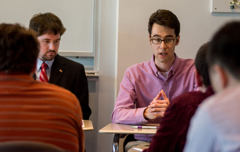 Dane Stier and David Friedman, members of College Republicans, discuss issues of income inequality at a student forum held Tuesday night. The event was organized as a collaboration between College Republicans, College Democrats and Quest Scholars.
