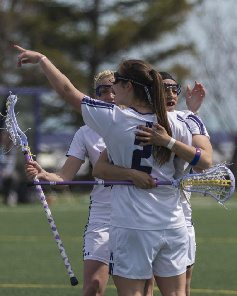 Senior+draw+control+specialist+and+NCAA+draw+control+record+holder+Alyssa+Leonard+hugs+her+teammates.+As+a+senior+member+of+the+squad%2C+Leonard+also+played+in+Northwestern%E2%80%99s+games+at+the+Los+Angeles+Memorial+Coliseum+in+2013%2C+Gillette+Stadium+in+Foxborough%2C+Mass.%2C+in+2012+and+Cowboys+Stadium+in+Dallas+in+2011.