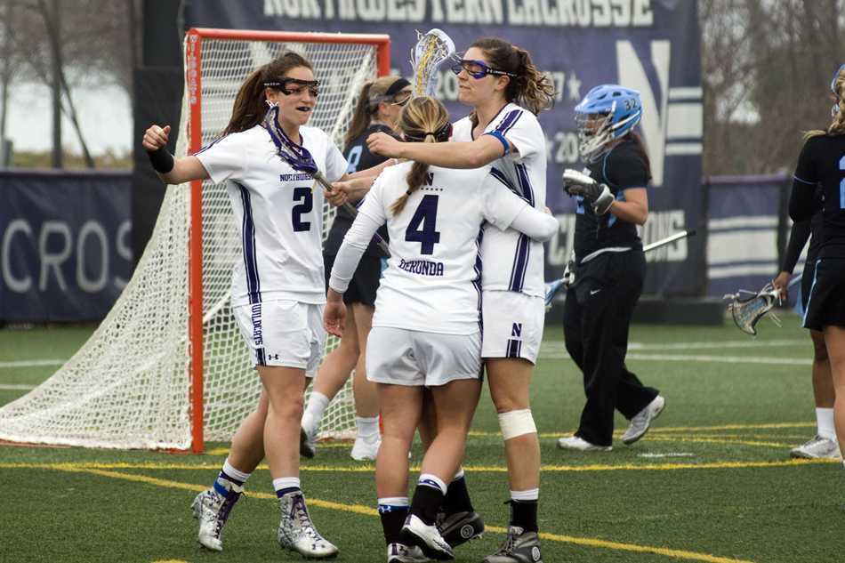 Senior draw control specialist Alyssa Leonard celebrates after a goal against  North Carolina. Coach Kelly Amonte Hiller praised Leonard's contributions this season and warned that her team can't rest on the senior's performance alone moving forward.