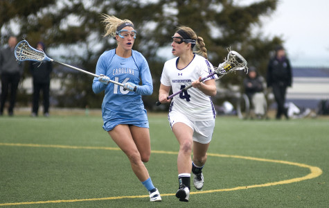 Senior Kat DeRonda goes up against a defender in the midfield. DeRonda had a fruitful weekend in Pennsylvania, leading Northwestern with 3 goals Friday against No. 10 Penn State and 2 goals Sunday in a win against No. 12 Pennsylvania.