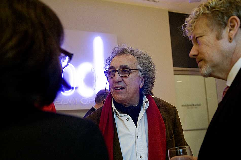 Moumen Smihi talks with Block Museum of Art staff members prior to the screening of two of his films Thursday night. Smihi is in Evanston for the presentation of his films, newly subtitled in English.