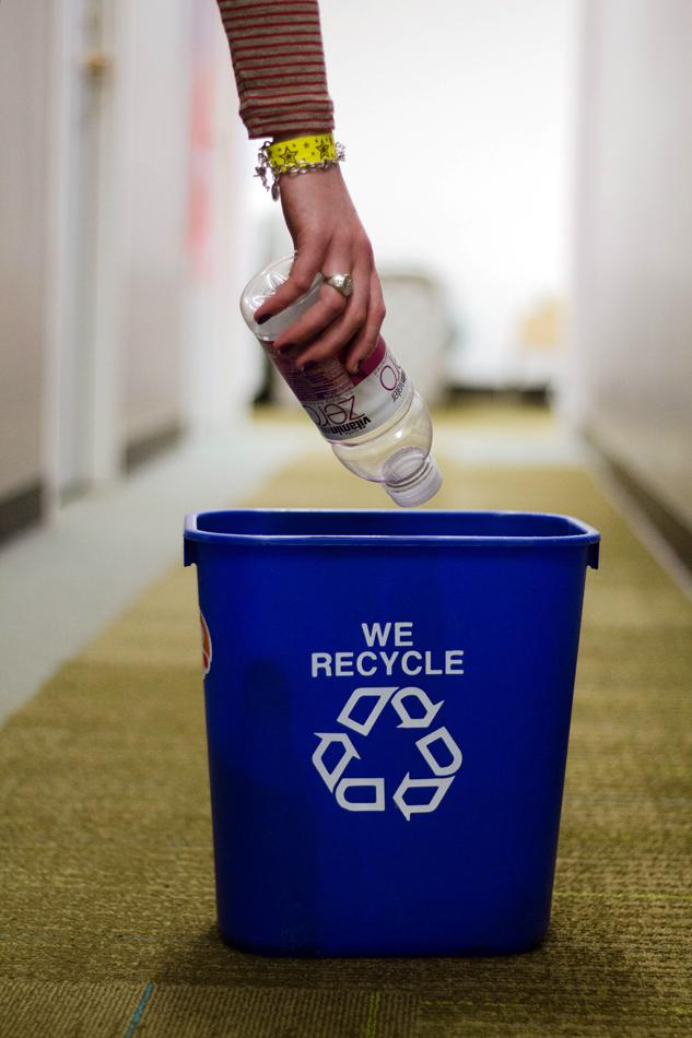 A+student+recycles+a+plastic+bottle+in+a+residence+hall.+Many+apartment+buildings+in+Evanston+lack+recycling+services+such+as+those+found+on+campus.