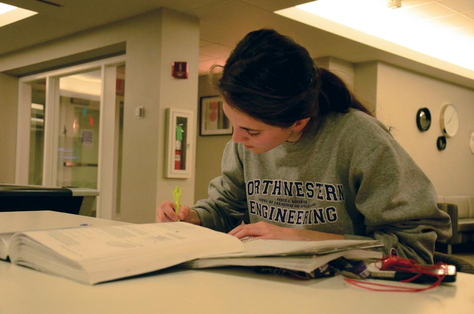 McCormick freshman Lauren Kearney studies in the Allison Hall first-floor lounge. Residence halls remained open over Spring Break for the first time this year as part of a new program.