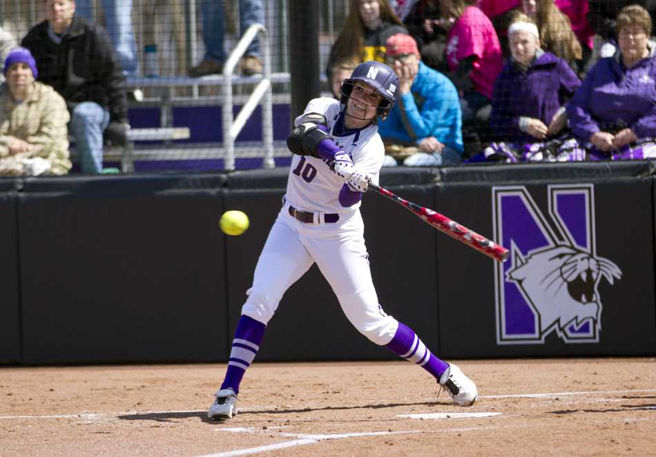 Andrea DiPrima swings at a pitch. The junior outfielder has recorded a hit in all but one of the Wildcats' games since March 21.