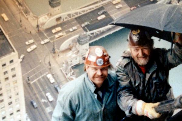 Construction worker Michael Kerr, left, died exactly one year ago while working on Northwestern's new Music and Communication Building after a crane knocked a beam from the sixth floor of the building.