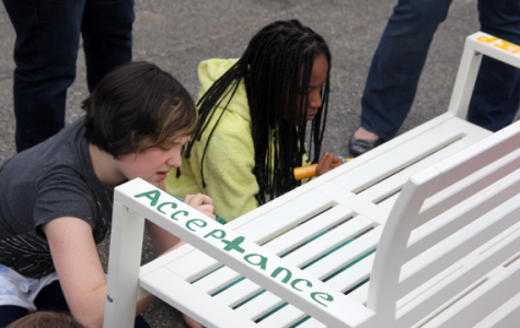 "D65 students paint a ""buddy bench"" that will be installed at their elementary school in an effort to fight bullying. The project comes from Caring Outreach by Parents in Evanston, a volunteer group that aims to provide for community families in need."